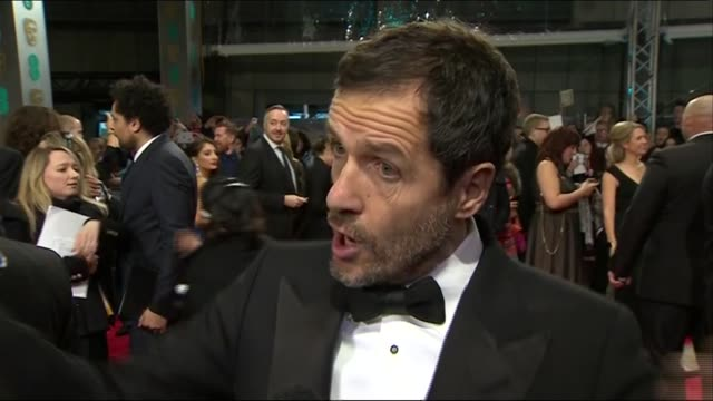 david heyman speaks about gravity during red carpet interview at the baftas 2014 - 2014 stock videos & royalty-free footage