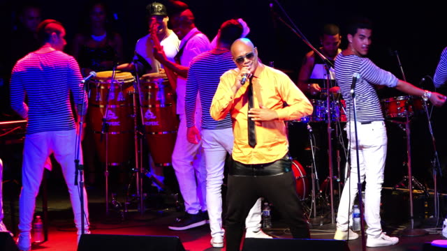 david is a renowned cuban musician his band plays popular dance music david calzado director and owner of la charanga habanera performs on a crowded... - salsa stock videos & royalty-free footage