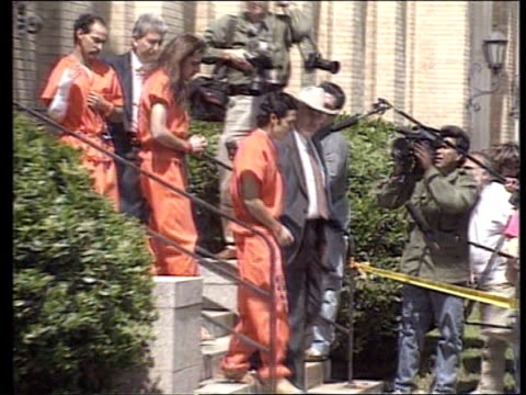 david koresh waco trial itn lib held in w'ton ms waco member in orange overalls pan rl as escorted by sheriff ms side more ditto as other defendants... - legal trial stock videos & royalty-free footage