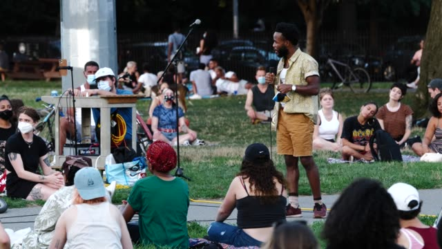 david lawrence glover leads participants into a moment of silence during the 54th night of the george floyd vigil at mccarren park. - poet stock videos & royalty-free footage