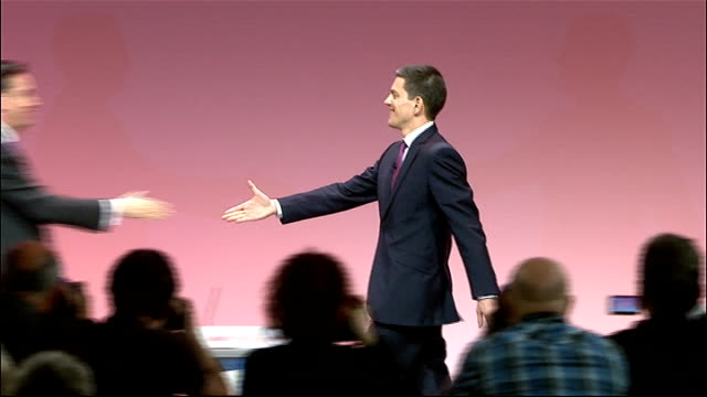 david miliband resigns as an mp t29091015 / tx david and ed miliband shaking hands and hugging on stage end lib - david miliband stock videos & royalty-free footage