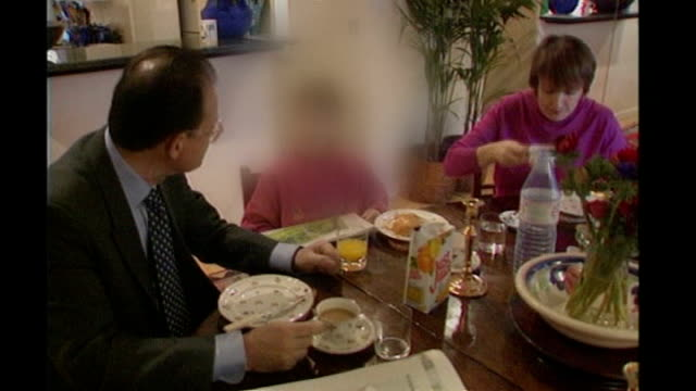 david mills found guilty of taking a bribe from silvio berlusconi t06119703 tessa jowell sat at table with husband david mills and son having... - bribing stock videos & royalty-free footage