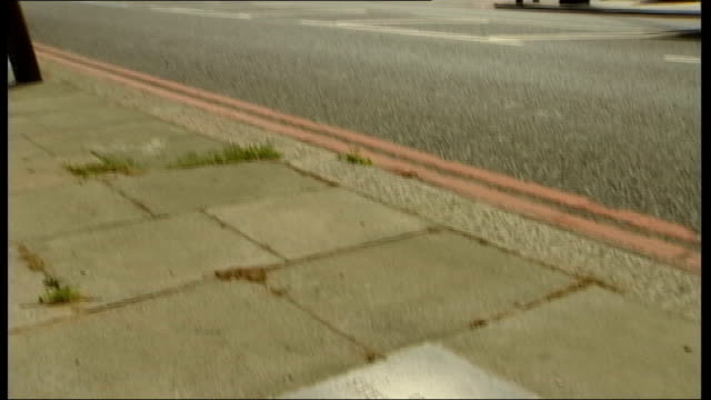 david norris/neil acourt jailed for assault eltham traffic along road tilt down to paving stone in memory of stephen lawrence ms sign for 'law... - paving stone stock videos and b-roll footage