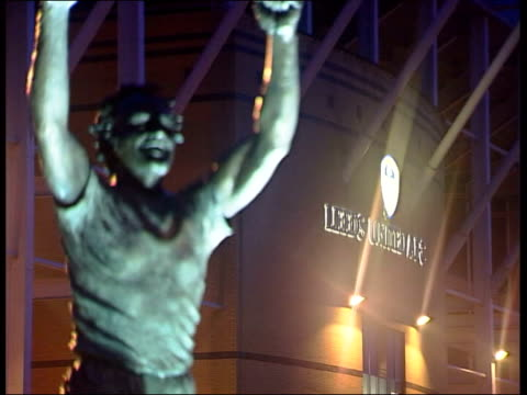 stockvideo's en b-roll-footage met david o'leary victim of hate mail england yorkshire leeds elland road statue of don revie with leeds united ground in b/g int css envelope addressed... - leeds