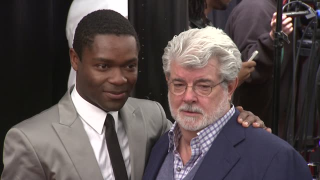 David Oyelowo and George Lucas at Red Tails Premiere Red Carpet New York NY United States