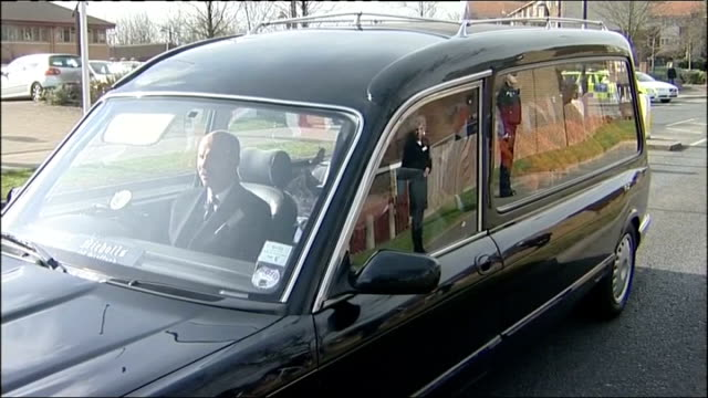 pc david rathband memorial service england newcastle upon tyne ext general view hearse pan to line of police - carro funebre video stock e b–roll