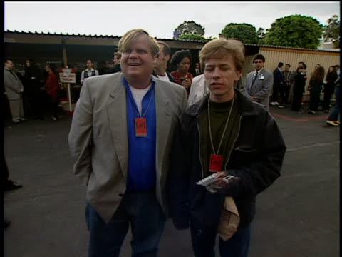 David Spade and Chris Farley are talking to the MTV cameramen David making Chris laugh