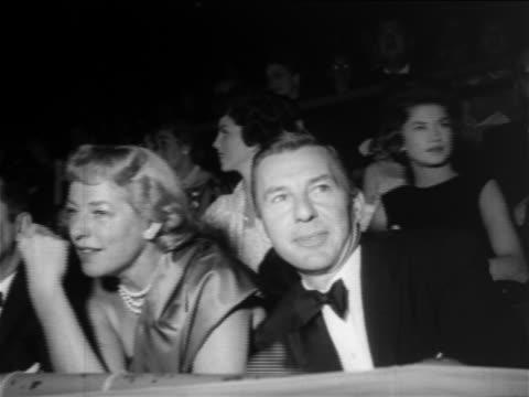 vídeos de stock, filmes e b-roll de david wayne + woman seated in madison square garden / mike todd's birthday party - 1956