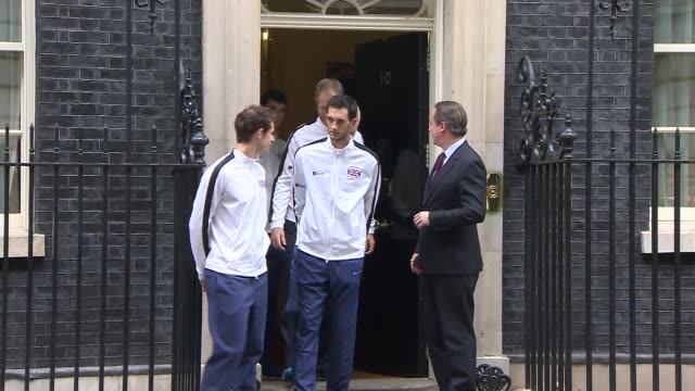andy murray visits downing street; downing street: ext british davis cup winning team; andy murray, james ward, jamie murray, dominic inglot, leon... - davis cup stock-videos und b-roll-filmmaterial