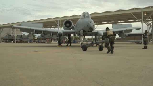 DavisMonthan Airmen preform A10 regeneration in MOPP gear during a base exercise