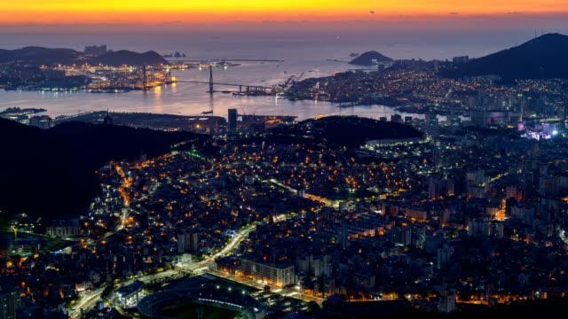 dawn and sunrise view of north harbor around siyak mountain in seogu, busan, south korea - busan stock videos & royalty-free footage