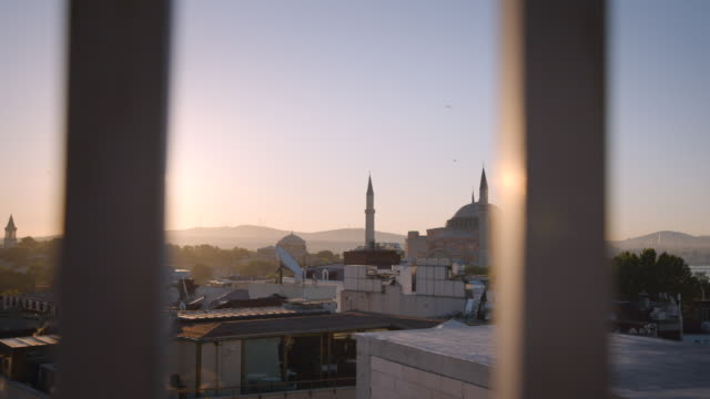 dawn and sunset view of hagia sophia mosque in istanbul, turkey - moschea video stock e b–roll
