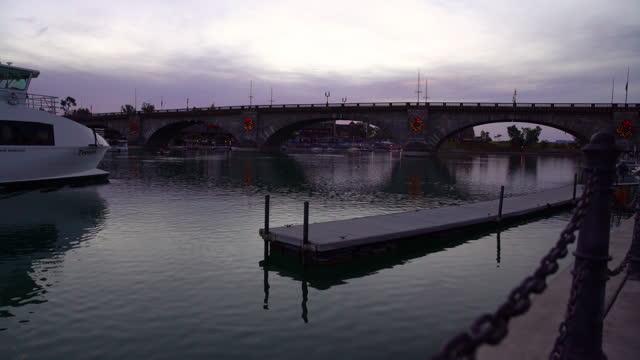 dawn breaking london bridge famous tourist destination arizona - bridge built structure stock videos & royalty-free footage
