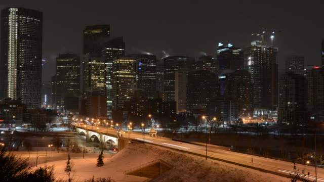 dawn breaks above cold city skyline - calgary stock videos & royalty-free footage