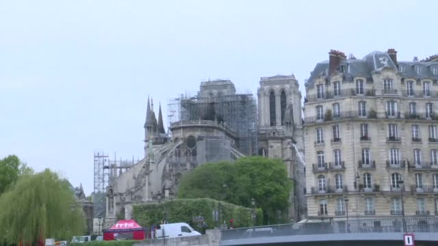 dawn breaks over notredame the morning after a devastating fire brought down its towering spire and roof wiping out centuries of priceless heritage... - spire stock videos and b-roll footage
