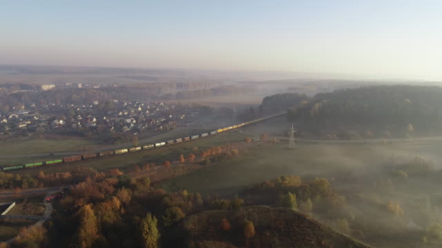 dawn in the morning. aerial drone shot. train passing curve - rail transportation stock videos & royalty-free footage
