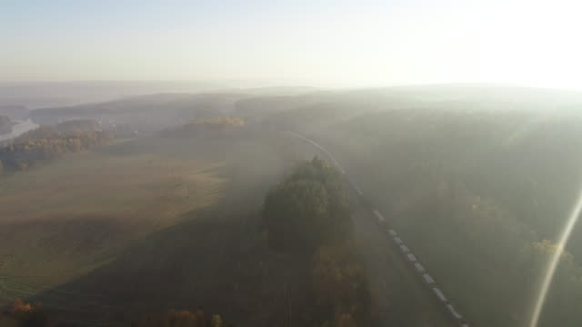 dawn in the morning. aerial drone shot. train passing curve - passenger train stock videos & royalty-free footage