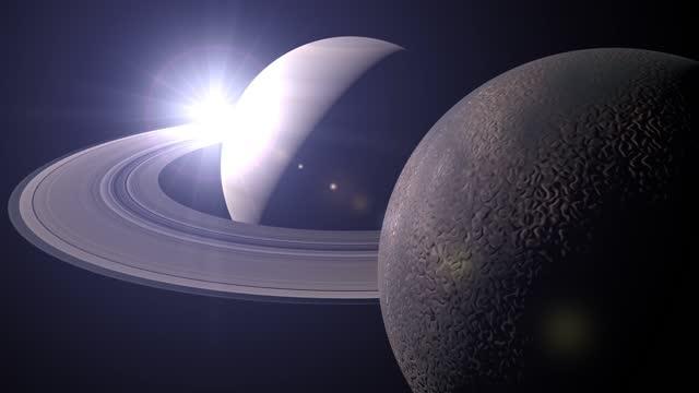 vídeos y material grabado en eventos de stock de amanecer en saturno y titán - titán luna