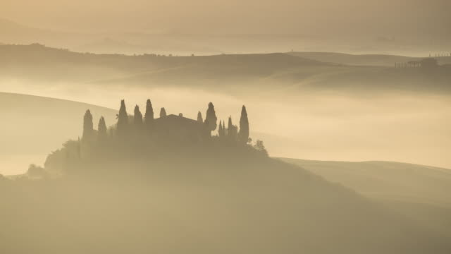Dawn on the the Val d'Orcia south of Siena, Tuscany.