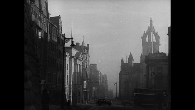 vidéos et rushes de b/w dawn over edinburgh, city on the hill, hayfield ready to harvest, military convoy driving through suburbs, the forth bridge in mist, truck driver signaling turn, military policeman signaling stop, and steering wheel / rosyth, scotland, united kingdom - écosse