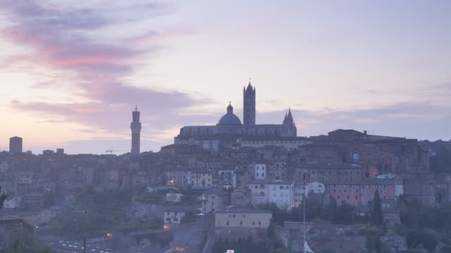 dawn over the city of siena, tuscany, italy. - torre del mangia stock videos and b-roll footage