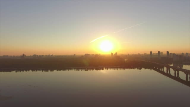 dawn over the dnieper river in kiev. aerial view - キエフ市点の映像素材/bロール