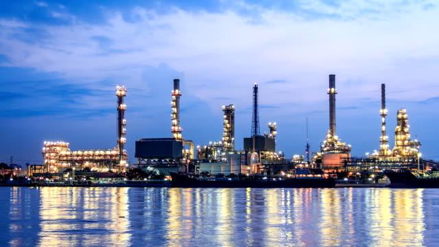 vídeos de stock e filmes b-roll de time lapse do amanhecer refinaria - central elétrica