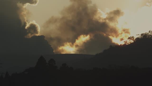 Dawn, smoke and clouds, Kirishima, Japan, February 2011