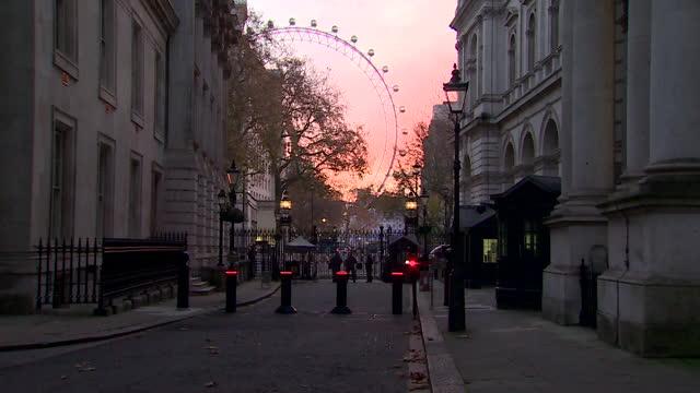 dawn, sunrise, in downing street, views of london eye - ランベス点の映像素材/bロール