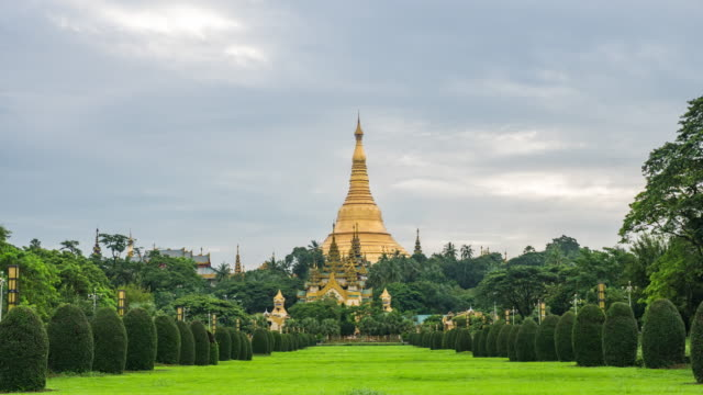 dawn to day time lapse, shwedagon temple at night stock video, yangon, myanmar - dawn to day stock videos & royalty-free footage