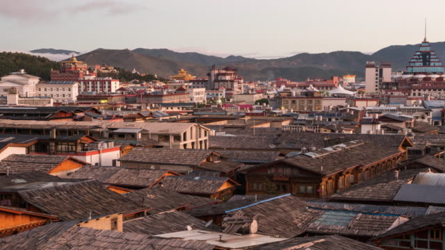 dawn to day time-lapse at shangri-la chinese ancient town, china - dawn to day stock videos & royalty-free footage