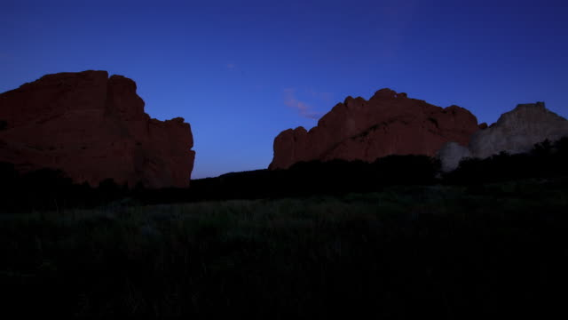 dawn to day view of crag at garden of god - dawn to day stock videos & royalty-free footage