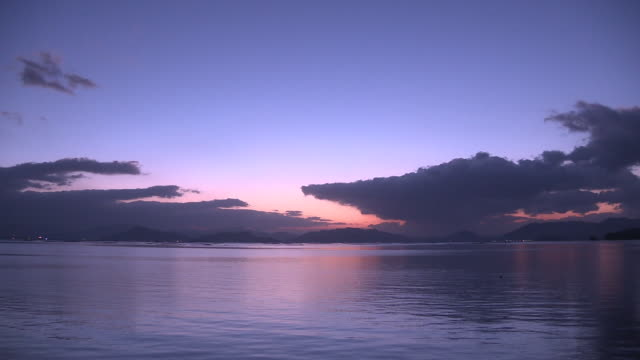 dawning sky over the sea, hiroshima, japan - purple background stock videos & royalty-free footage