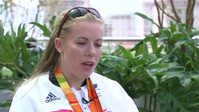 day 10 team gb passes target of 121 medals hannah cockcroft with reporter gold medals hannah cockcroft interview sot - itv weekend evening news点の映像素材/bロール