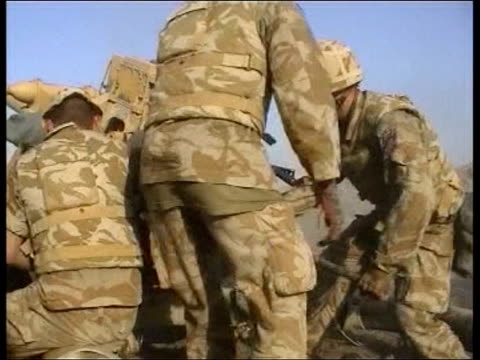 day 12 evening news pool/lower quality picture iraq near basra artillery pieces of the royal horse artillery being loaded and fired / soldiers taking... - artiglieria video stock e b–roll