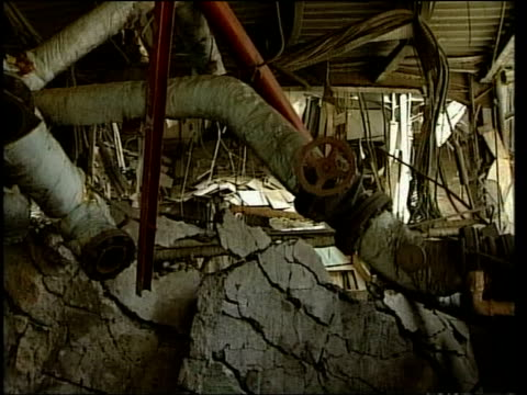 vídeos de stock, filmes e b-roll de news at nine; itn for itv ext gv telephone exchange building damaged in air raid cms telephone exchange equipment cms wrecked pipework i/c side... - air raid