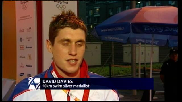 day 13 int david davies interview sot swimming in zigzags hitting buoys - richard pallot stock-videos und b-roll-filmmaterial