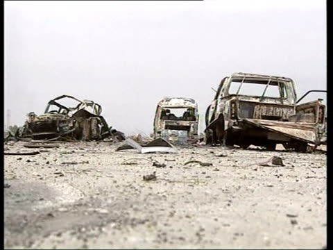day 13 lunchtime news pool najaf ms wrecked vehicles at scene of suicide bomb attack that killed 4 us soldiers cms remains of vehicle that was... - najaf stock-videos und b-roll-filmmaterial