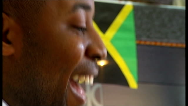 vídeos y material grabado en eventos de stock de day 14: birmingham basks in limelight after praise from jamaican sprinters; int barber and customer at hairdressers visited by jamaican athletes... - jamaiquino