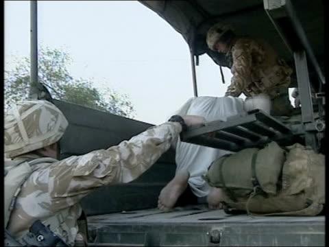 day 14 evening news evening news bill neely iraq umm qasr ext/int at night/green pix nightsight pictures of british royal marine soldiers raiding... - army helmet stock videos & royalty-free footage