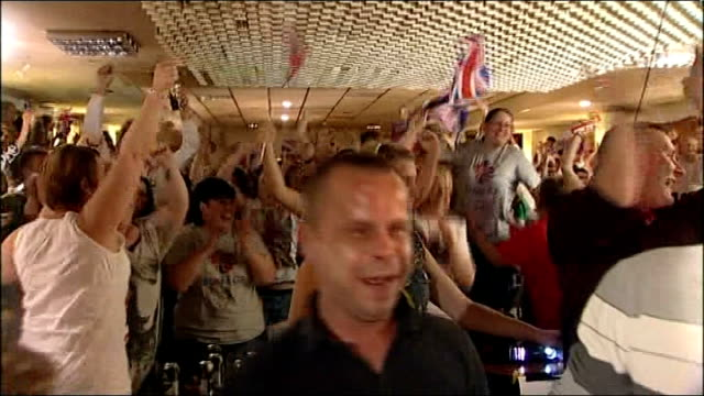 day 14 taekwondo wales flint crowd of jade jones supporters celebrate her victory as watching women's taekwondo olympic final on television in bar /... - wales stock videos & royalty-free footage