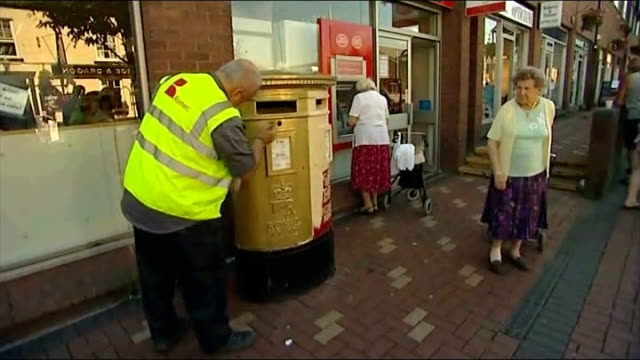 day 14: taekwondo; wales: flint: ext man painting local post box gold - wales stock videos & royalty-free footage