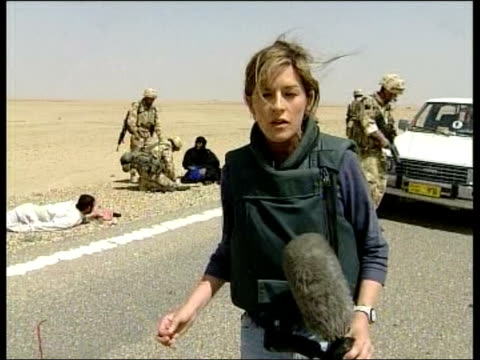 Day 15 Evening News fEVENING NEWS ANDREA CATHERWOOD IRAQ Nassiriya EXT LMS Lorry flying white flag being stopped by British Gurkha troops CMS White...