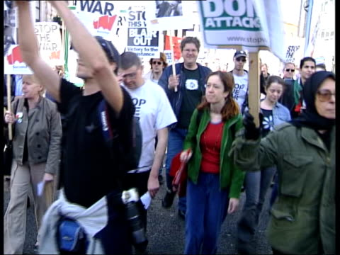 day 17 1720 news 1720 damon green england london ms antiwar protestors along past ms side police officers lining street as protestors pass cbv... - damon green stock videos and b-roll footage