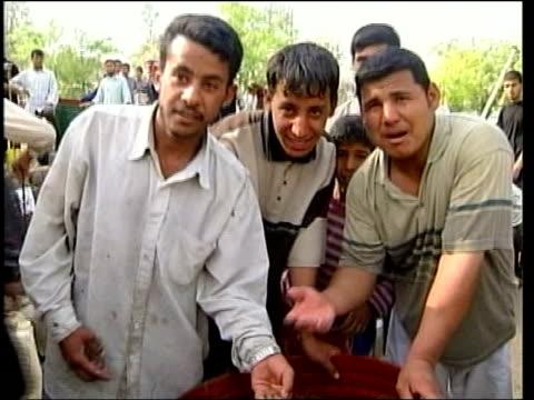 news; 21.00: dan rivers iraq: umm qasr: ext cms side iraqi children running along track cms iraqi boy saying 'water' sot people gathered around... - iraq stock videos & royalty-free footage
