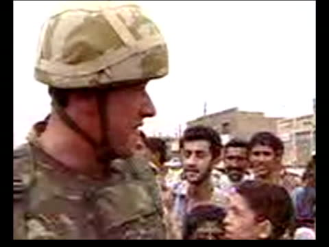 evening news; evening news: juliet bremner basra iraq: basra: ext poor quality videophone pix troops from 1st fusiliers along streets as entering... - basra stock-videos und b-roll-filmmaterial