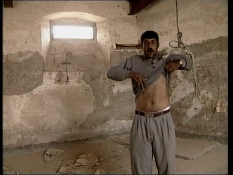 Day 19 News at Nine NEWS AT NINE U'LAY Torture IRAQ Basra EXT GV Building which housed suspected prison torture chamber with mural of Saddam Hussein...