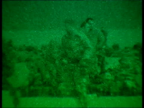 day 2 evening news special pool kuwait ext seq green night sight royal marines soldiers boarding sea knight helicopters seq green night sight royal... - day 1 stock videos and b-roll footage