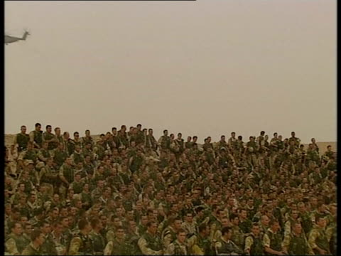 lunchtime news bulletin; lunchtime bulletin - sue saville pool iraq: ext seq iraqi men surrendering to british royal marines on road seq green night... - イラク点の映像素材/bロール