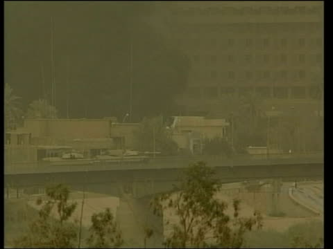 day 20 evening news evening news neil connery hotel iraq baghdad american abrams tank firing with big gun from bridge as huge explosion heard sot men... - 2003 stock videos and b-roll footage